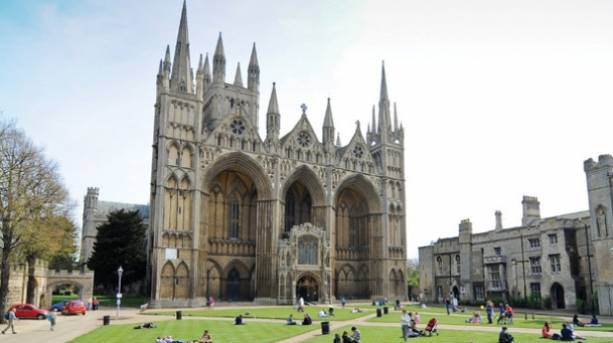 People sitting outside Peterborough Cathedral