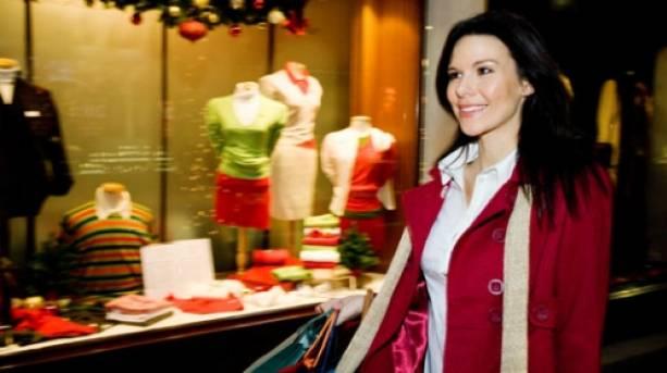 Woman shopping in Burlington Arcade at Christmas, Piccadilly, London, London, England.