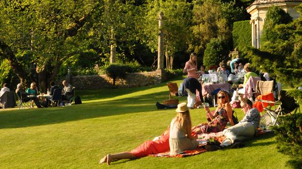 Groups of people picnicking at Iford Arts Festival