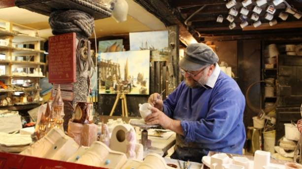 A man decorating a jug at Great Yarmouth Potteries and Smoke House