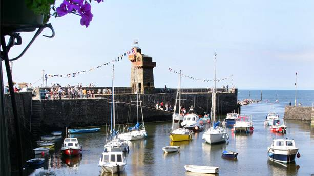 Relax by Lynmouth's historic harbour and see the fishing boats come and go