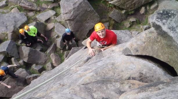 Climbers ascending a rock face