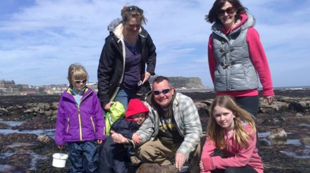 A family rock pooling in Scarborough