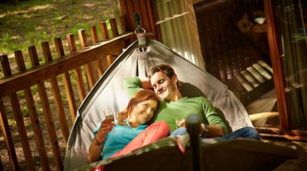 A couple lying in a hammock