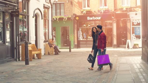 A couple shopping in Covent Garden, London