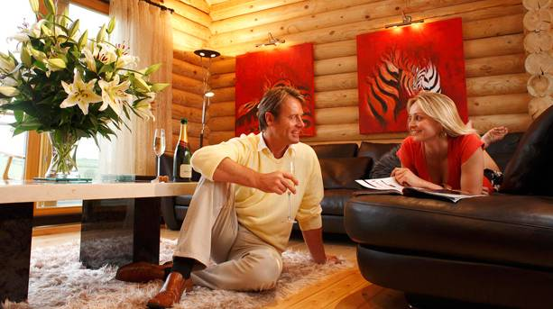A couple relaxing in a lodge