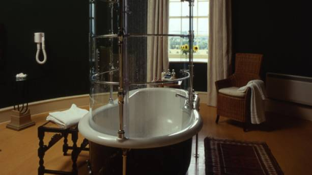 A luxury bath standing in the middle of a room at Swinton Park