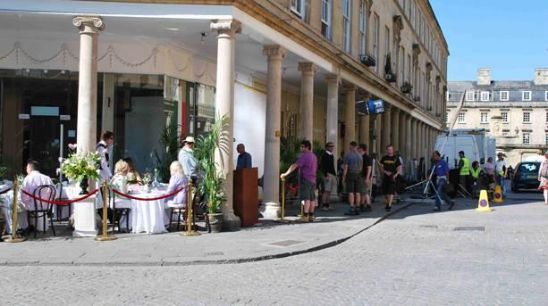 A film crew filming a scene in Bath