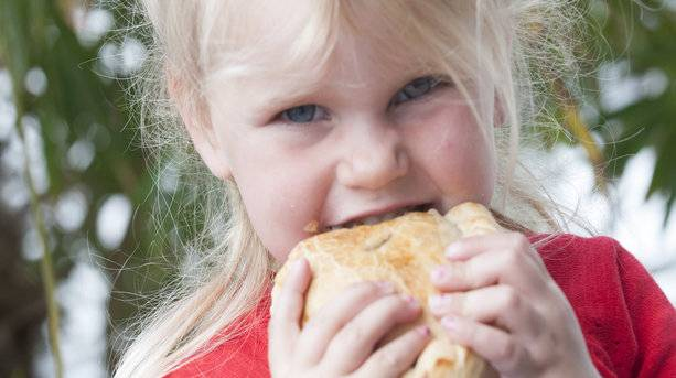 Child Eating a Cornish Pasty
