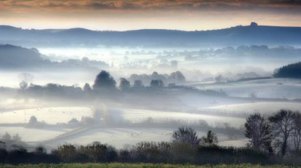 The Vale of Wardour covered in fog in Wiltshire