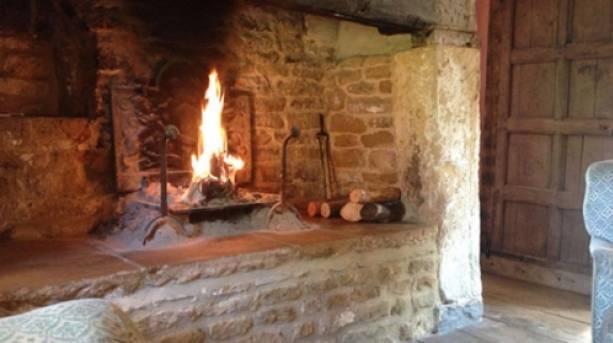 A fireplace inside Secret Cottage