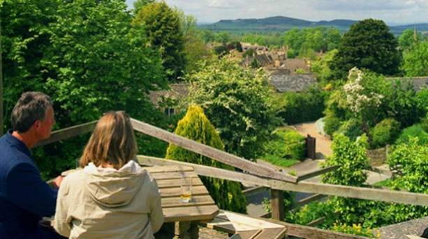 A couple looking at the view of Stanway Village