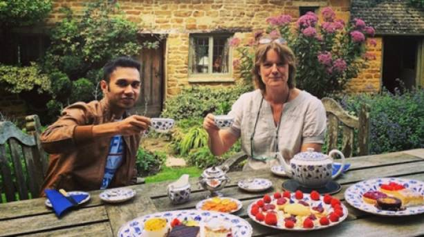 The Spice Traveller enjoying tea and cake in the garden