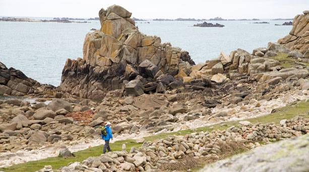 A walker on a rocky path in St Agnes