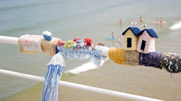 Knitted items left by the mysterious Saltburn Yarn Bombers