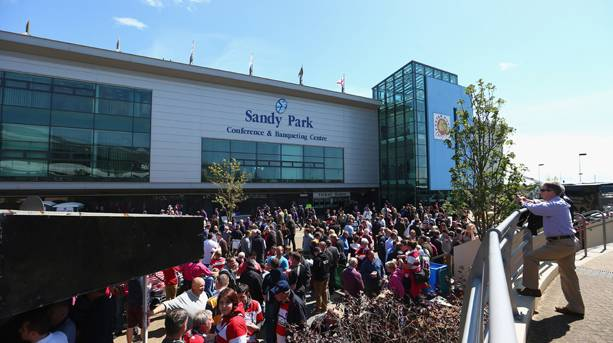 A crowd of people outside Sandy Park