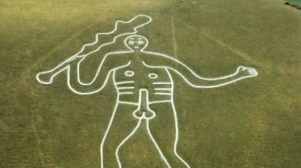The Cerne Giant overlooking the village of Cerne Abbas in Dorset, England