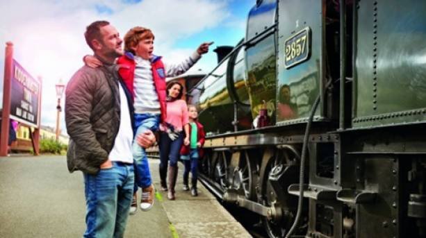 A family looking at a steam locamotive on the Severn Valley Railway