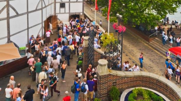 A crowd of people outside Shakespeare's Globe