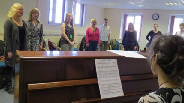 A group of ladies at a singing class