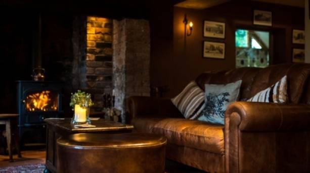 Woodburner and sofa at Pheasant at Neenton