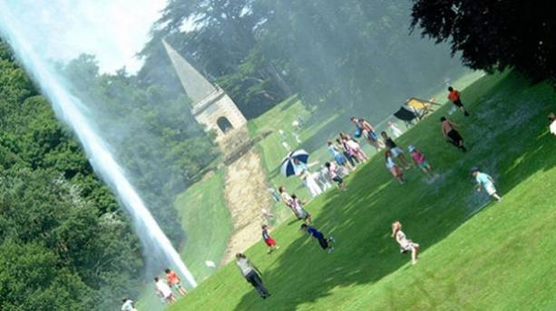 A group of people playing under Stanway Fountain