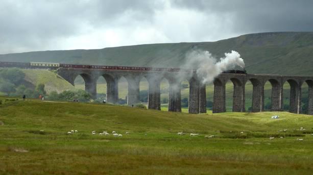A steam train crossing Ribblehead viaduct