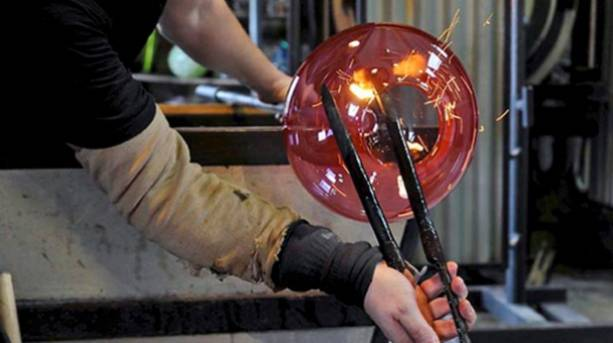 Stephen Gillies of Gillies Jones crafting one of their distinctive glass bowls