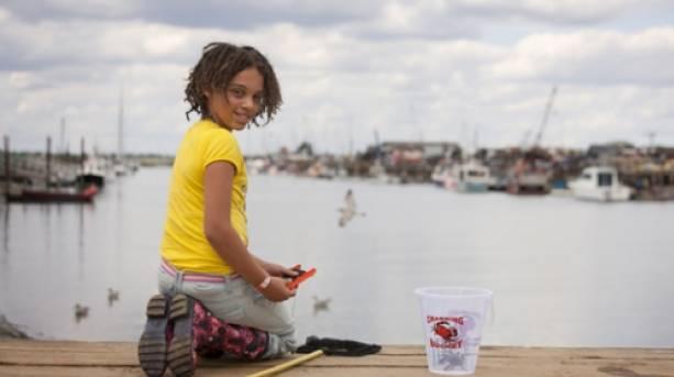 Ten year old girl crabbing at Walberswick, Suffolk
