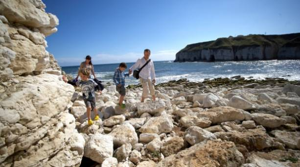 A group of kids rock pooling on the Yorkshire Coast