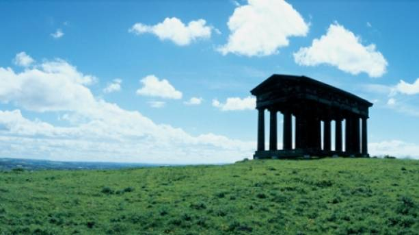 Penshaw Monument on top of the hill with blue sky