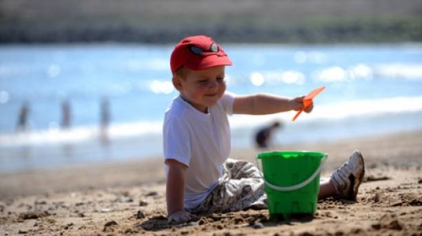 Child playing with bucket and spade