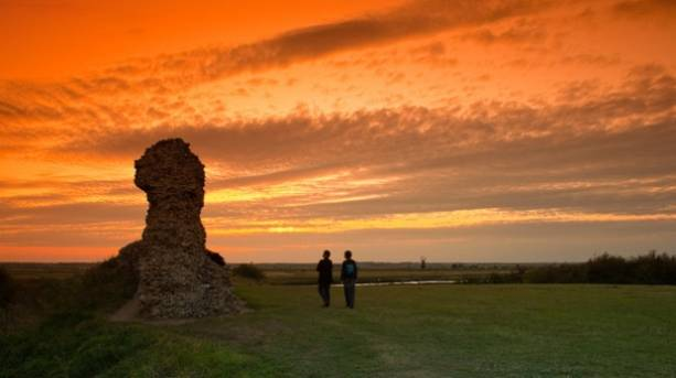 Sun sets over Burgh Castle on the Angles Way
