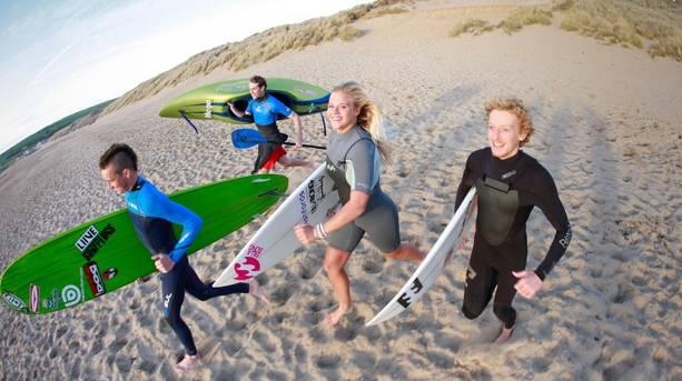 Surfers on Croyde Beach