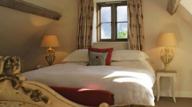 A bedroom in The Swan Inn at Swinbrook