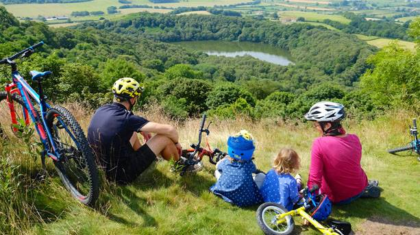 A family taking a rest to admire the view over Lake Gormire, Sutton Bank