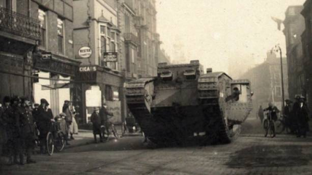 The first tanks are paraded through the streets of Lincoln.