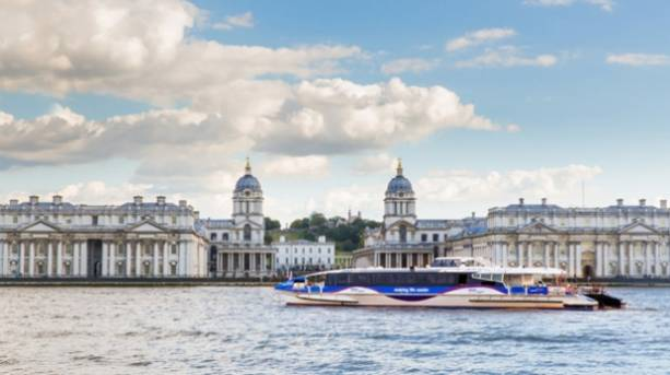 A Thames Clipper boat travelling up the river