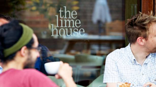 Two people drinking tea outside The Lime House Café in Nottinghamshire