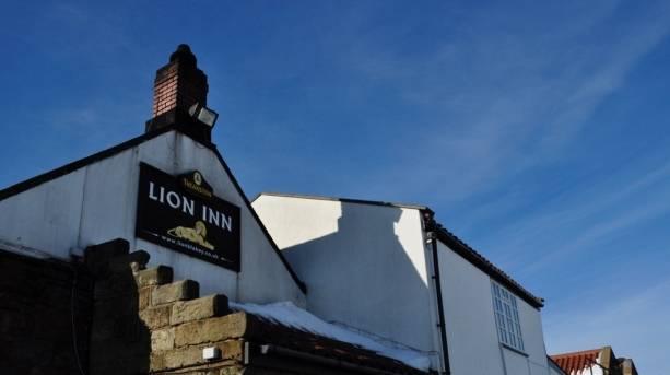 Walkers sat near Ralph Cross near the Lion Inn