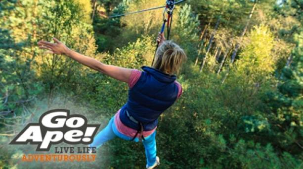Flying down the zip wire at Go Ape!, Peak District