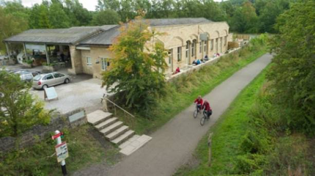 Cyclists on the Monsal Trail passing Hassop Station