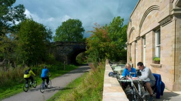 Cyclists stopping off at Hassop Station, Peak District