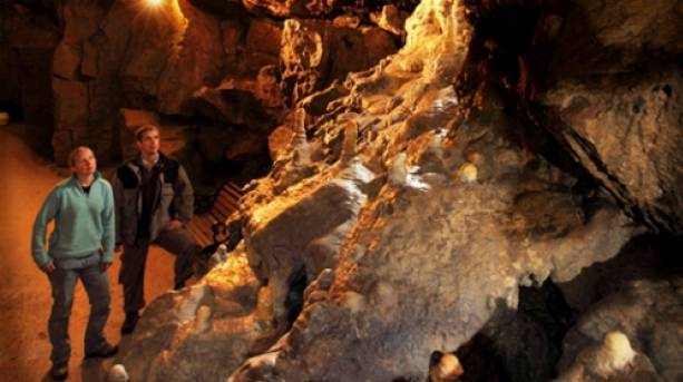 Couple admiring the formations at Pooles Cavern