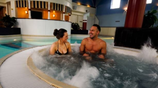 Couple enjoying the Aqua Relaxation Room in the Alton Towers resort