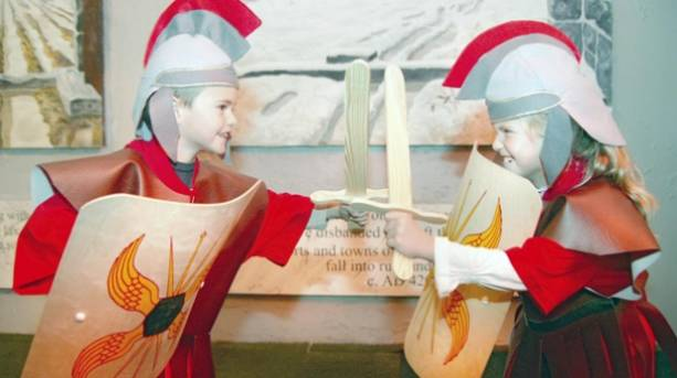 A boy and girl dressed in Roman army gear at the Roman Army Museum
