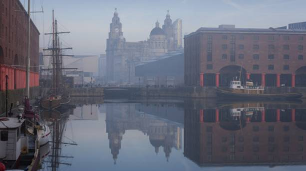 Maritime Albert Dock on Liverpool waterfront with the Three Graces historic buildings.