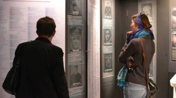 Two people at the Titanic & Liverpool: the untold story exhibition