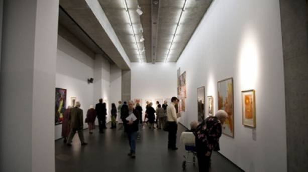 People looking at paintings at Towner in Eastbourne