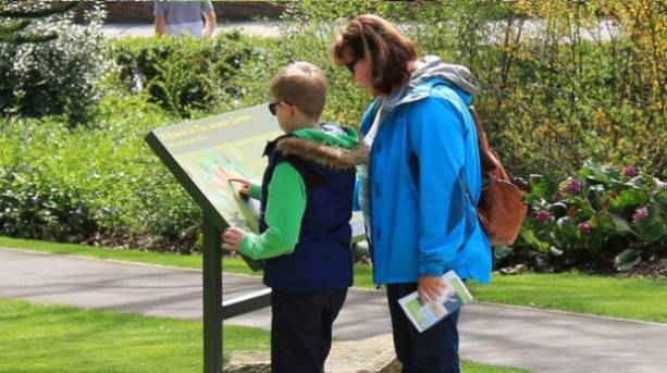 A family on a treasure trail at Whitby West Cliff and Pannett Park